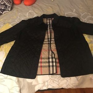Women's Burberry quilted trench jacket.